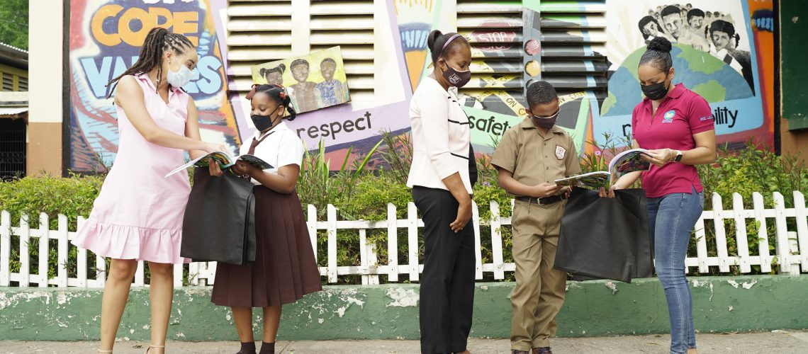 Amashika Lorne lead a handing over activity for grade 4 students at St. Francis Primary School in Kingsotn Jamaica.